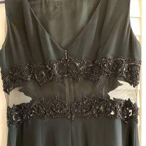 Rich beaded black Cache' dress - Size 4.